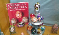 """Kara Lopez's artistry. We asked Kara how she got started in the art of Pysanky - Ukrainian Easter Eggs, she said; """"Pysanky has been part of my life since I was young. My older sister learned from her future Mother-in-law and let me try my hand at it. I was hooked immediately!"""" She mentioned that the supplies are inexpensive which made this a great hobby when she began, then added, """"I spent many late nights in my teen years working on my eggs. As my skill grew, I started giving away eggs as gifts to friends and family. I preferred to give them away as opposed to putting a price tag on them to sell."""" Kara took a break from the hobby after her first son was born as she focused on raising her children. However, by the time her third son was a year old, she decided to dust everything off and revive Pysanky in her life once again. Kara said, """"I remember telling some good friends about Pysanky, and asking them if they'd like to try it with me. I didn't do a very good job of describing it though, because they told me later they were bewildered as to why I was so excited about making """"Paas Easter Eggs"""". They were envisioning the typical way we decorated eggs as kids at Easter time. Pysanky is actually created with the wax-resist method. The designs are """"written"""" in hot wax using a tool called a Kistka, and the colors are created with dyes. Once my friends tried it, they were hooked too!"""" Since then, with the help of good friends, she has figured out how to share this art with children as young as 2 years old. Kara shared, """"I've taught my children's and friends' classmates in art class at school; and I've used it as a way to fellowship with other women at church. It's a hobby I can sit down and work together on with my sons. However my most rewarding experience to date has been the opportunity to re-create an egg that belonged to a friend of mine. She adopted her second son from Ukraine, and brought back a Ukrainian Easter Egg (Pysanka) when they brought him home. It hung on """