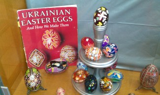 "Kara Lopez's artistry. We asked Kara how she got started in the art of Pysanky - Ukrainian Easter Eggs, she said; ""Pysanky has been part of my life since I was young. My older sister learned from her future Mother-in-law and let me try my hand at it. I was hooked immediately!"" She mentioned that the supplies are inexpensive which made this a great hobby when she began, then added, ""I spent many late nights in my teen years working on my eggs. As my skill grew, I started giving away eggs as gifts to friends and family. I preferred to give them away as opposed to putting a price tag on them to sell."" Kara took a break from the hobby after her first son was born as she focused on raising her children. However, by the time her third son was a year old, she decided to dust everything off and revive Pysanky in her life once again. Kara said, ""I remember telling some good friends about Pysanky, and asking them if they'd like to try it with me. I didn't do a very good job of describing it though, because they told me later they were bewildered as to why I was so excited about making ""Paas Easter Eggs"". They were envisioning the typical way we decorated eggs as kids at Easter time. Pysanky is actually created with the wax-resist method. The designs are ""written"" in hot wax using a tool called a Kistka, and the colors are created with dyes. Once my friends tried it, they were hooked too!"" Since then, with the help of good friends, she has figured out how to share this art with children as young as 2 years old. Kara shared, ""I've taught my children's and friends' classmates in art class at school; and I've used it as a way to fellowship with other women at church. It's a hobby I can sit down and work together on with my sons. However my most rewarding experience to date has been the opportunity to re-create an egg that belonged to a friend of mine. She adopted her second son from Ukraine, and brought back a Ukrainian Easter Egg (Pysanka) when they brought him home. It hung on their Christmas tree every year, until it was accidentally dropped onto a tile floor. Thankfully, they had enough of the shell left that I could see the design and re-create a new egg for them."" She was also able to teach the art to her friend's son, who is Ukrainian by birth. Kara says, ""I am by no means a pro, but I have truly been blessed by this hobby and the friendships that it has led me to."""