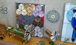 """Some of Jeff Dyer's stained glass projects. He started working with stained glass at his sister's in Tampa. """"It started as just something to do to occupy myself,"""" he says. """"...it turned into something that I do in the winter months to keep me busy and cut down on smoking at the same time. It's very consuming work. But when you see your finished project, it's well worth the time spent."""""""