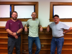 Mike Carl, Jason Carl and Larry Carl. Larry built the shelves dedicated in memory of RoBerta Thomas.