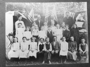 History Mystery Photo #4 The Heyworth Public Library holds in it's archive this picture of a group photo with no other information. If anyone can give us any clues to this mystery picture, we would be very interested in learning more about the people and the location it may have taken place at.