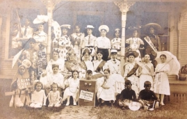 History Mystery Photo #1 The Heyworth Public Library holds in it's archive this picture of a group of youth we think dates back to 1920 - 1925? Some of the youth are wearing sashes with the names of Heyworth area businesses. We know this from our newspaper indexing project that is currently in progess in the same time period. The name Della Van Valey is inscribed on the back of the group photo. This picture will be on display at the library for anyone to come and get a better look. We would love to have more information about who is in this picture, where it was taken, and why it was taken?