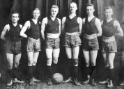 History Mystery Photo #6 The Heyworth Public Library holds in its archive this picture of a Heyworth High School basketball team from 1919. We thought this would be fun to look at after the amazing game last week of our current boys basketball team. We don't think the shoes look all that comfortable, nor the knee-pads all that helpful compared to today's standards. If anyone can give any information about this team or if you hold a yearbook from this year, we would be very interested in learning more.