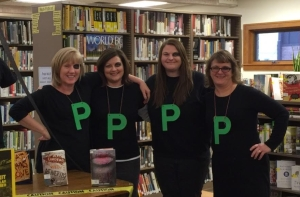 Heyworth Public Librarians dressed as Black Eyed Peas to celebrate Halloween 2015.  (Pictured from left to right: Beth Porter, Lori Urban, Jordan Gray, and our newest library clerk Tammy Burk.)  Over 50 books were given away to costumed children 10.29.15.